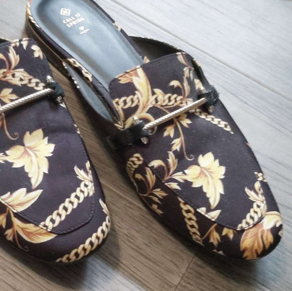 Call it Spring black and gold flats